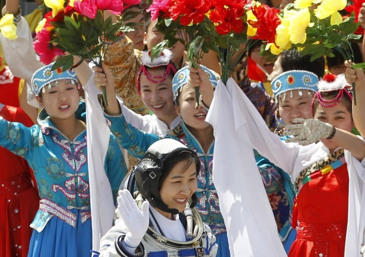 Liu Yang, China's first female astronaut, waves during a departure ceremony at Jiuquan Satellite Launch Centre, 16.06.12
