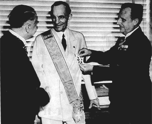 German diplomats award Henry Ford, centre, their nation's highest decoration for foreigners, the Grand Cross of the German Eagle, July 1938