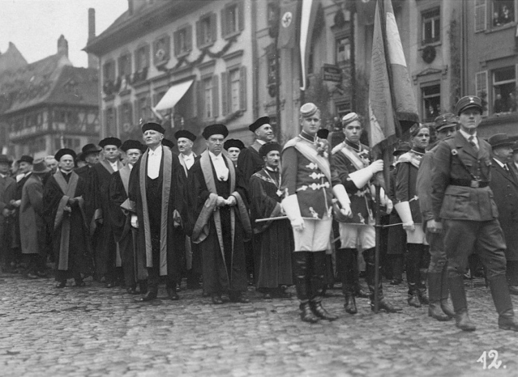 Heidegger, middle of 2nd row, on his way to give his first address as Rektor of the University of Freiburg, 27.05.33. He joined the Nazi party on the 1st of May.