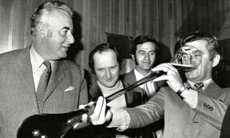Prime minister Gough Whitlam watches ACTU president Bob Hawke drink beer from a yard glass Melbourne, Australia, 1972. Photograph: News Ltd/Newspix/REX