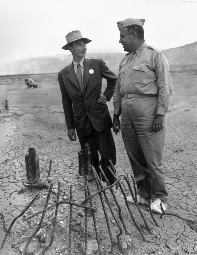 Robert Oppenheimer and General Groves at Trinity Test Ground Zero, 1945. The white canvas overshoes were to prevent fallout from sticking to the soles of their shoes.