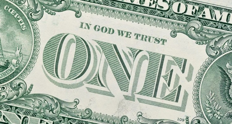 US dollar bill - In God We Trust. The motto of the United States 'In God we trust' was adopted by Congress in 1956 in response to fears of Godless 'communism'.