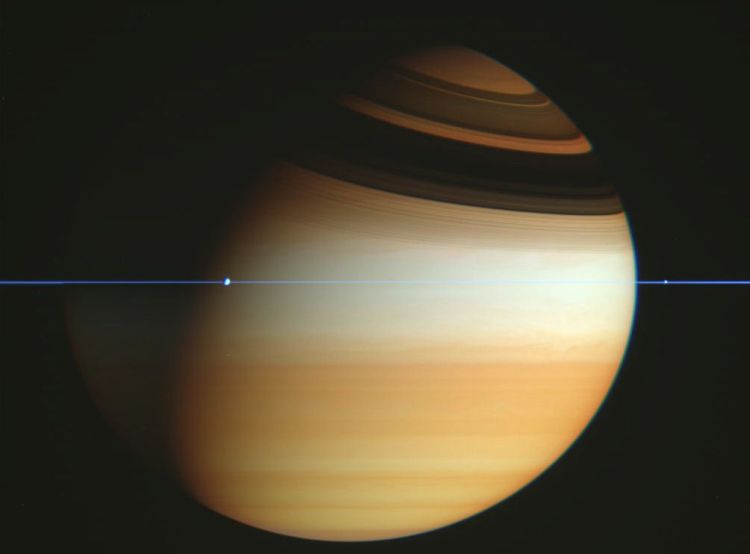1. Cassini spacecraft crosses Saturn's ring plane. Moons appear as bumps in the rings