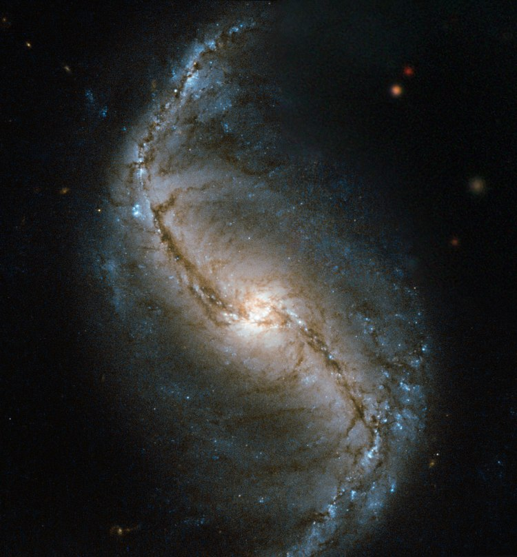 6. The barred spiral galaxy NGC 986 discovered in 1828 by James Dunlop
