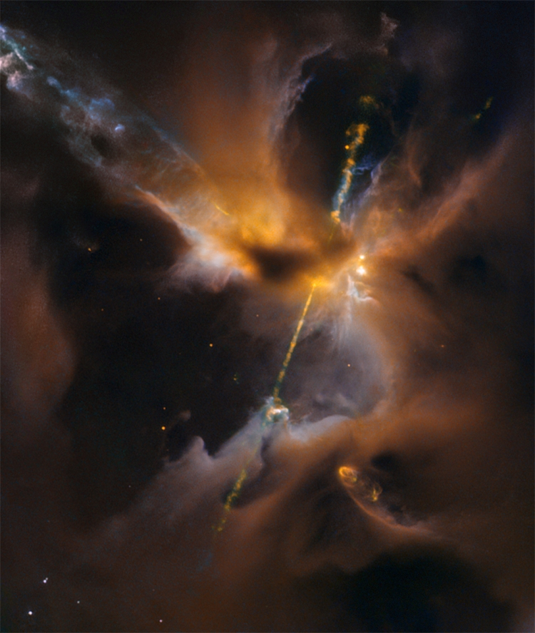 Two cosmic jets beam outward from a newborn star. Half a light-year span across Herbig-Haro 24, 1,300 light-years away in Orion B molecular cloud complex.